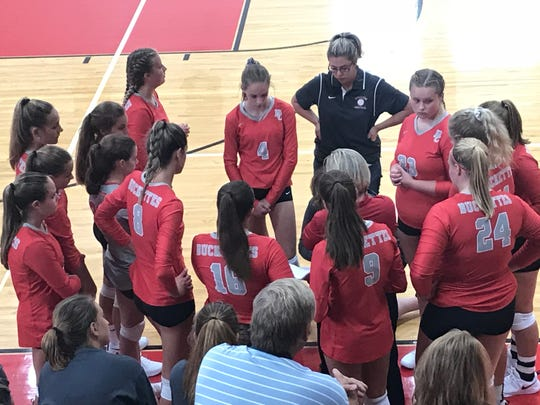 The Buckeye Central Buckettes gather around head coach Paige Caudill to talk strategy before their second set against the Crestview Lady Cougars.