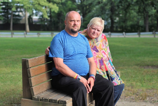 Patrick and Susan Hill sit on a bench at McKinley Park on Wednesday. Susan attempted to take her life more than two years ago by swallowing two handfuls of Percocet.