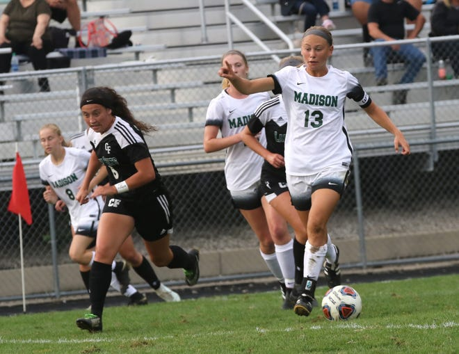 Madison's Taylor Huff kicks the ball down the field while at Clear Fork on Friday night.