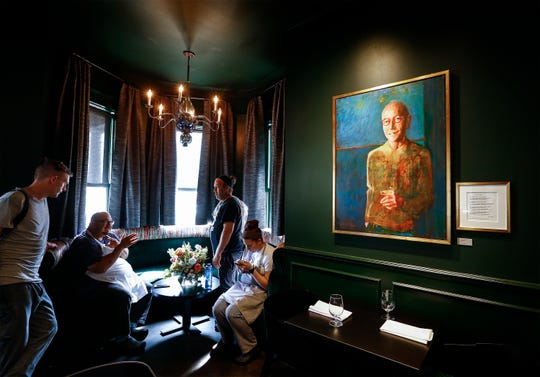 A portrait of Jackie Glisson, who was the designer of the original Restaurant Iris and a close friend of English. Glisson passed away before the recent remodel of the popular Overton Square restaurant and English had the portrait commissioned in his honor.