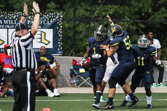 Lausanne's Eric Gray Jr., 1, and Carson Webb, 52, celebrate after Gray ran for a touchdown during Friday's season-opening game versus Rosa Fort (Mississippi) on Aug. 17, 2018.