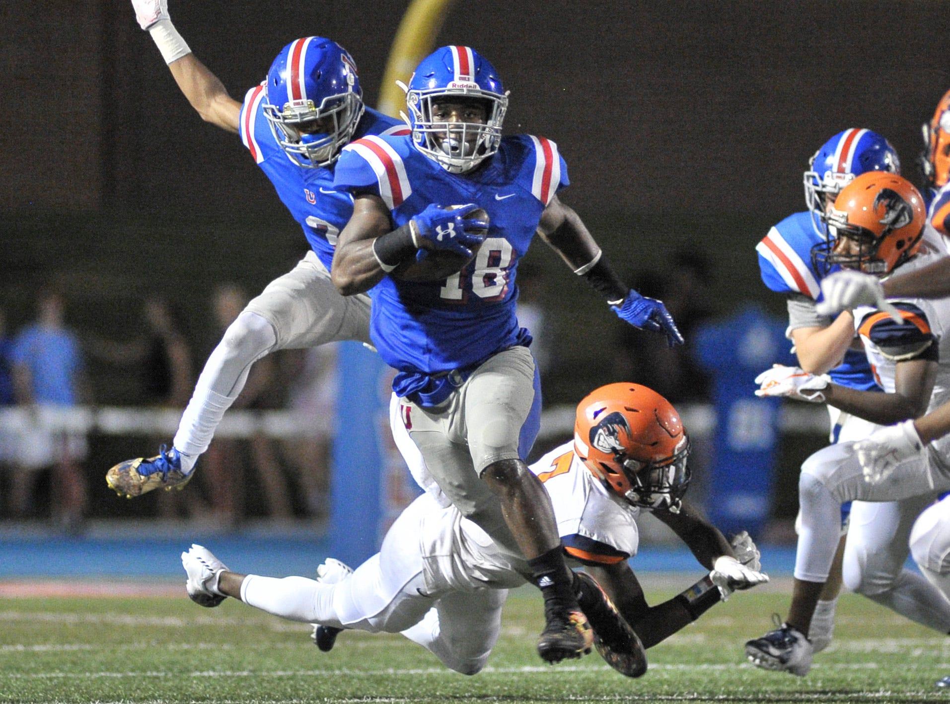 Memphis University School's Maurice Hampton carries the ball against Ridgeway at Memphis University School.