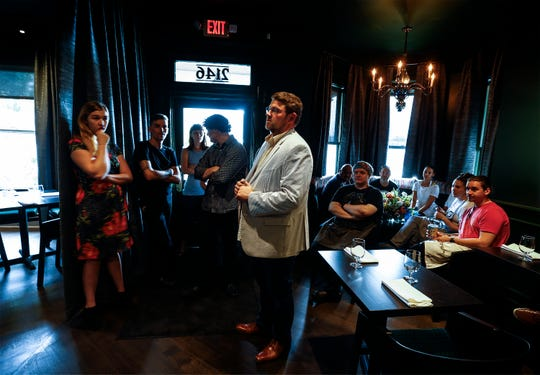Kelly English (middle), owner/chef of Restaurant Iris, talks with his staff before their soft opening of the newly remodeled popular restaurant in Overton Square.