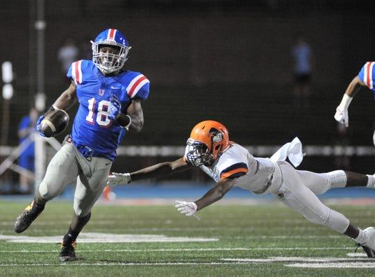 Memphis University School's Maurice Hampton avoids a Ridgeway defender Friday.