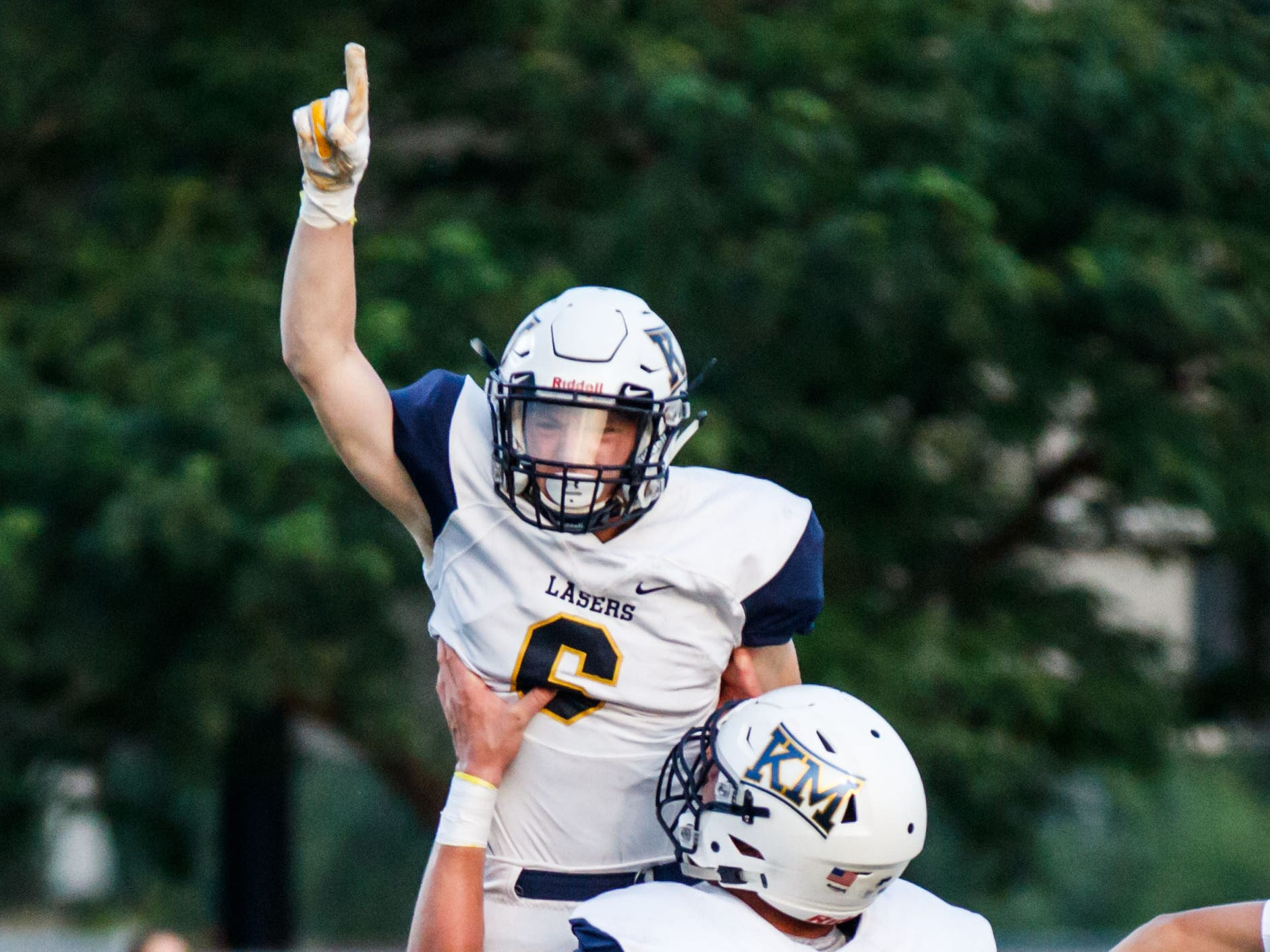 Kettle Moraine receiver William Knutson (6) celebrates his 46-yard touchdown reception with lineman Jacob Rock  during the first quarter at Waukesha West on Friday, August 17, 2018.