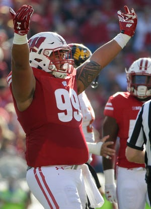 Senior nose tackle Olive Sagapolu will lead a Badgers defensive line that is young and inexperienced.