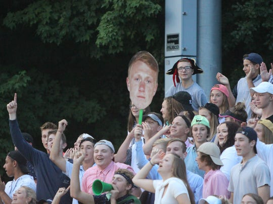 The Port Washington student section holds up a cutout of wide receiver Jacob Lippe during a game against Homestead on August 17.
