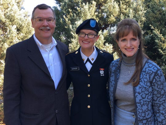 James Burhop, a surgeon, was commissioned Saturday into the U.S. Army Reserve by his daughter Rebecca Burhop, now a 2nd. Lieutenant in the Army. Also shown in this older photo is his wife, Lynn Burhop.