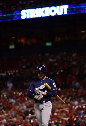 The Brewers' Ryan Braun walks back to the dugout after striking out during the ninth inning.