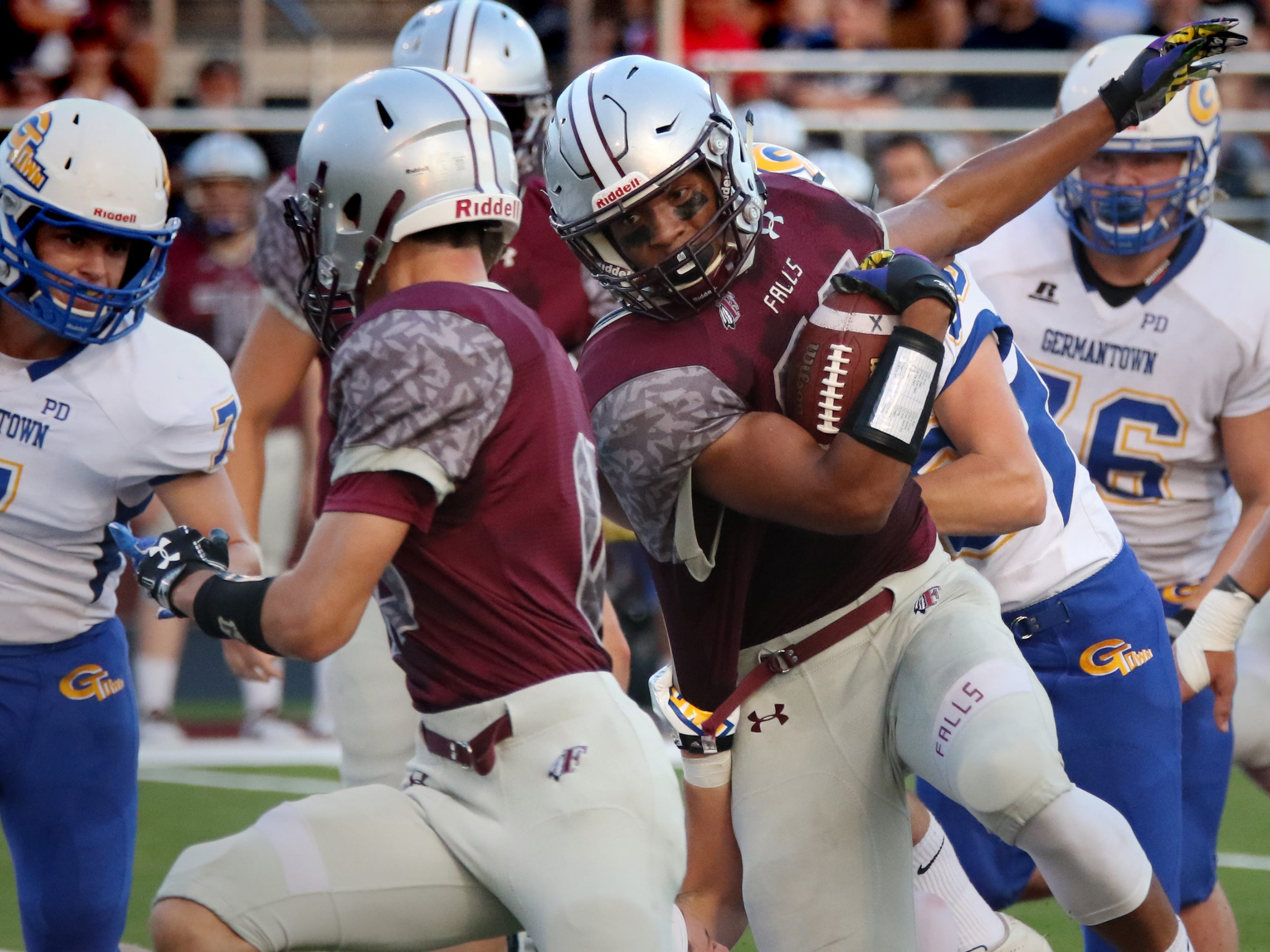 Menomonee Falls running back Julius Davis drives through the Germantown defense on Friday night. Davis, a Wisconsin Badgers recruit, finished with 33 carries for 334 yards and three touchdowns in the game.
