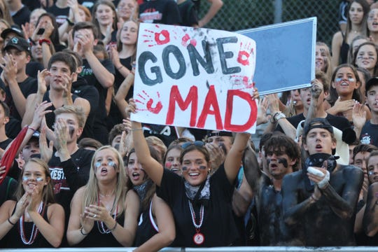 The Homestead student section cheers on its football team during the first half of the 2018 season opener against Port Washington.
