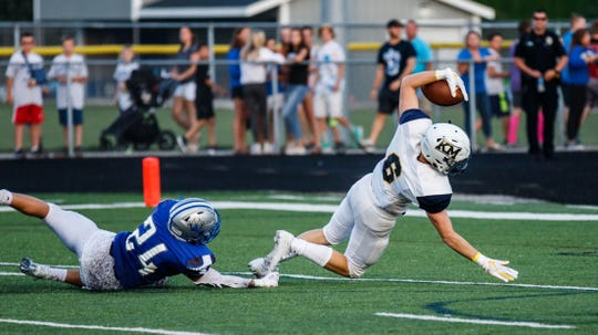Kettle Moraine receiver William Knutson dives into the end zone on a 46-yard touchdown reception during the first quarter against host Waukesha West on Friday, August 17, 2018.