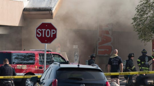 Milwaukee firefighters battle a blaze at the Family Dollar store Saturday, Aug.  18, 2018, at 2601 W. Hampton Ave.