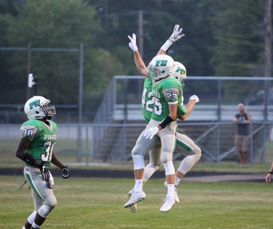 Port Washington wide receivers Jacob Lippe (42) and Mitchell Niemayer celebrate Lippe's touchdown catch against Homestead on August 17.