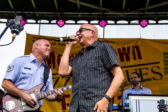 From left, guitarist Tech Sergeant Jason Cole, USAF, and Mark Pender, vocalist and trumpet, star of Conan and also performing with Labamba & the Hubcaps, perform with Rhythm in Blues, the Air Force band, at the 2018 Morristown Jazz & Blues Festival on the Green in Morristwon, August 18, 2018.  Photo by Warren Westura for the Daily Record.