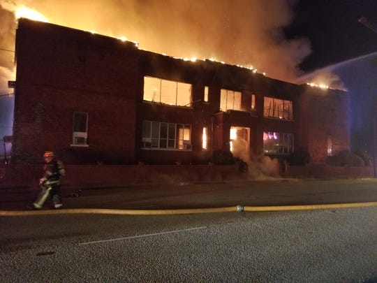 A fire destroyed a building early Saturday at Booker T. Washington Magnet High School.