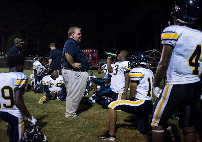 Success Unlimited Academy head coach Bill Granger talks with his team during halftime at Springwood High School in Lanett, Ala., on Friday, Aug. 17, 2018. Springwood defeated Success Unlimited Academy 23-12.