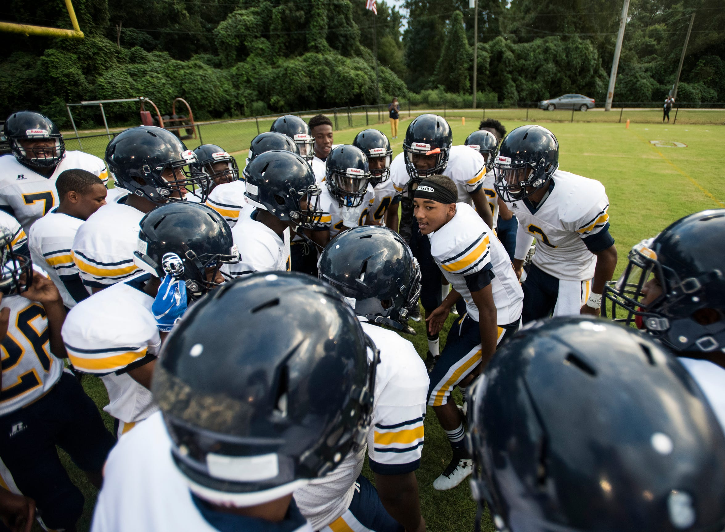 Success Unlimited's Andre Wesley (2) pumps up his team before they are introduced at Springwood High School in Lanett, Ala., on Friday, Aug. 17, 2018. Springwood defeated Success Unlimited Academy 23-12.