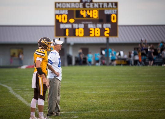 Monroe Central coach John Hochstetler talks with Logan Patterson during the game against Anderson Prep Academy on Aug. 17 at Monroe Central Jr.-Sr. High School. The game ended with a win for Monroe Central and a final score of 60-0.