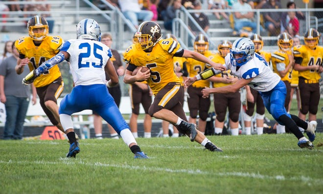 Monroe Central's Seth Wilson makes it past one of his defenders during the game against Anderson Prep Academy on Aug. 17 at Monroe Central Jr.-Sr. High School. Monroe Central won the game 60-0.
