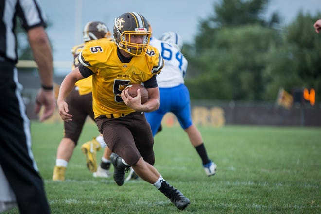 Monroe Central's Seth Wilson runs against Anderson Prep Academy on Aug. 17 at Monroe Central Jr.-Sr. High School. The game ended with a win for Monroe Central and a final score of 60-0.