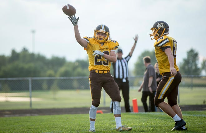 Monroe Central's Kamron Caldwell scores against Anderson Prep Academy  on Aug. 17 at Monroe Central Jr.-Sr. High School. The game ended with a win for Monroe Central and a final score of 60-0.