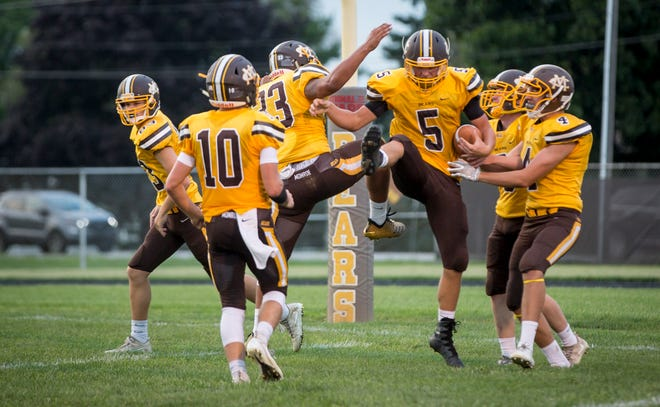 Monroe Central's Seth Wilson celebrates with teammates during a game against Anderson Prep Academy on Aug. 17 at Monroe Central Jr.-Sr. High School. The game ended with a win for Monroe Central and a final score of 60-0.