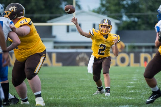Monroe Central's Jackson Ullom throws against Anderson Prep in the season opener. Ullom's first start came the next week against Union City.