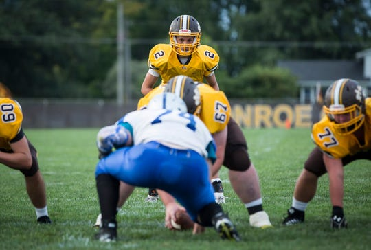 Monroe Central's Jackson Ullom waits for the snap against Anderson Prep in the season opener. Ullom has thrown for 1,570 yards and 14 touchdowns this season.