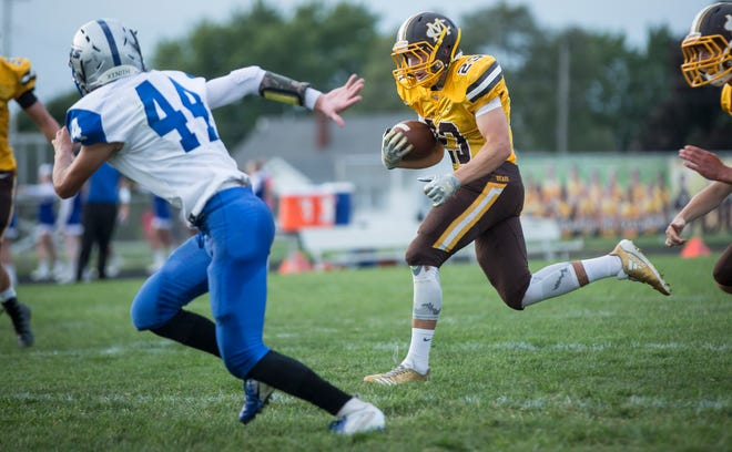 Monroe Central's Kamron Caldwell runs against Anderson Prep Academy  on Aug. 17 at Monroe Central Jr.-Sr. High School. The game ended with a win for Monroe Central and a final score of 60-0.