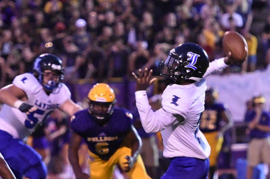 La Vergne quarterback Issac Ridley fires a pass during Friday's loss at Smyrna.