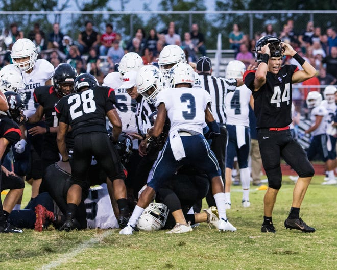 Siegel and Stewarts Creek players scuffle after a play that ultimately led to two ejections on Friday night.