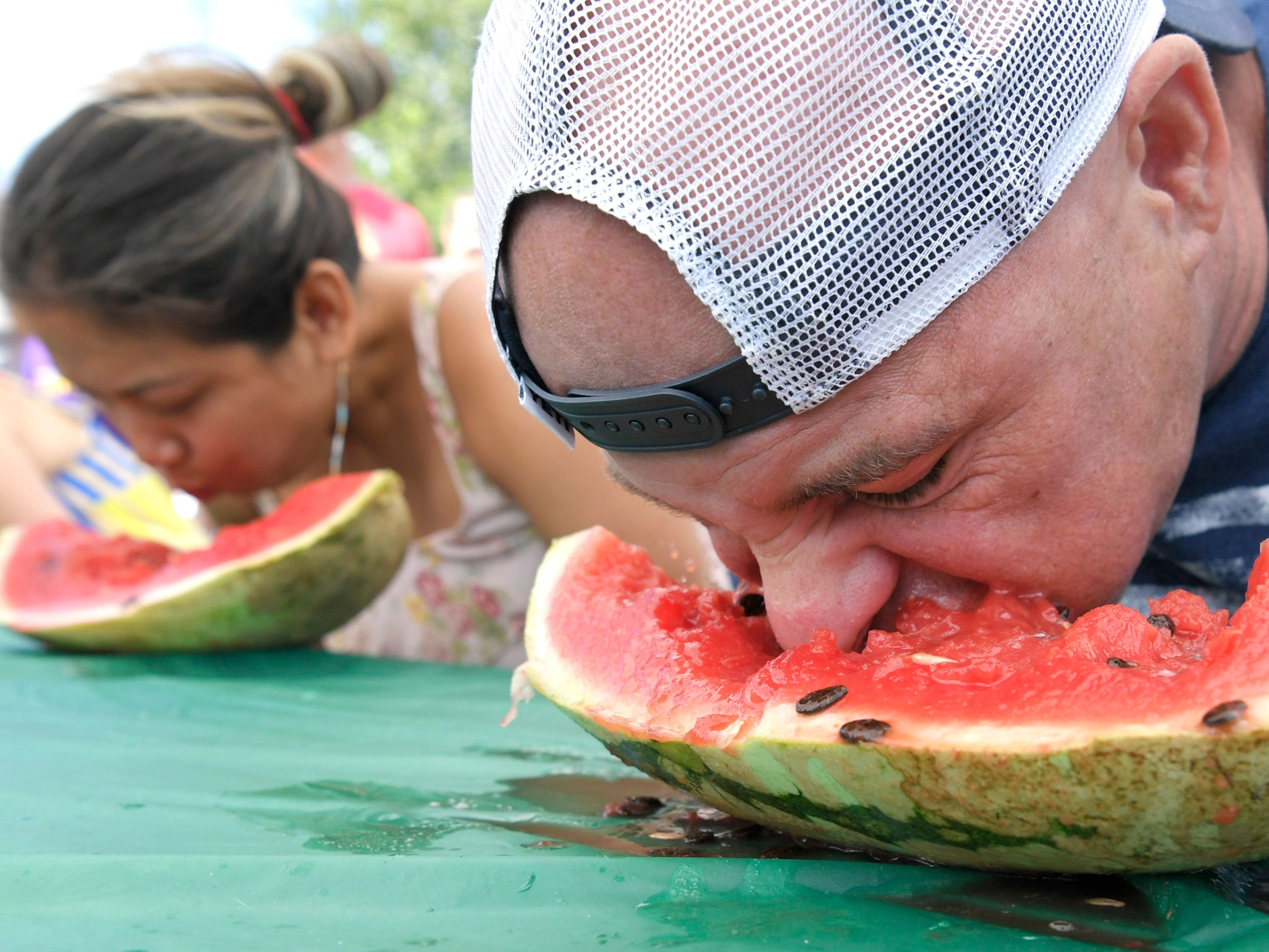 Tim Malone competes in the adult watermelon eating contest during Franklin Watermelon Festival  at the Franklin Farmers Market in Franklin, Tenn. on Saturday,  August 18, 2018.