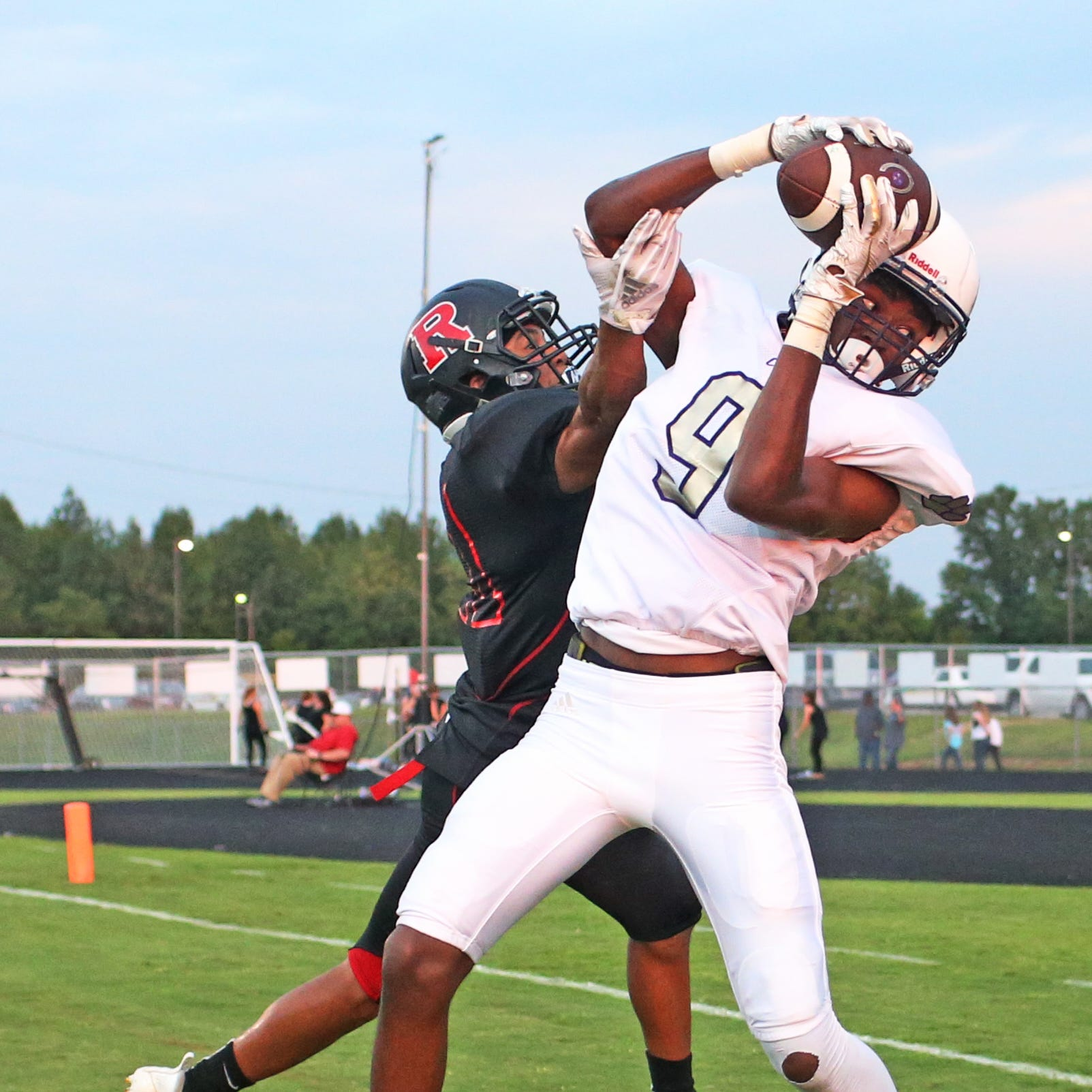 Clarksville's Neko Clark (9) pulls in a touchdown catch over Rossview's KJ Montague (21) during the first game of the season at Rossview High School Friday, Aug. 17, 2018, in Clarksville, Tenn.
