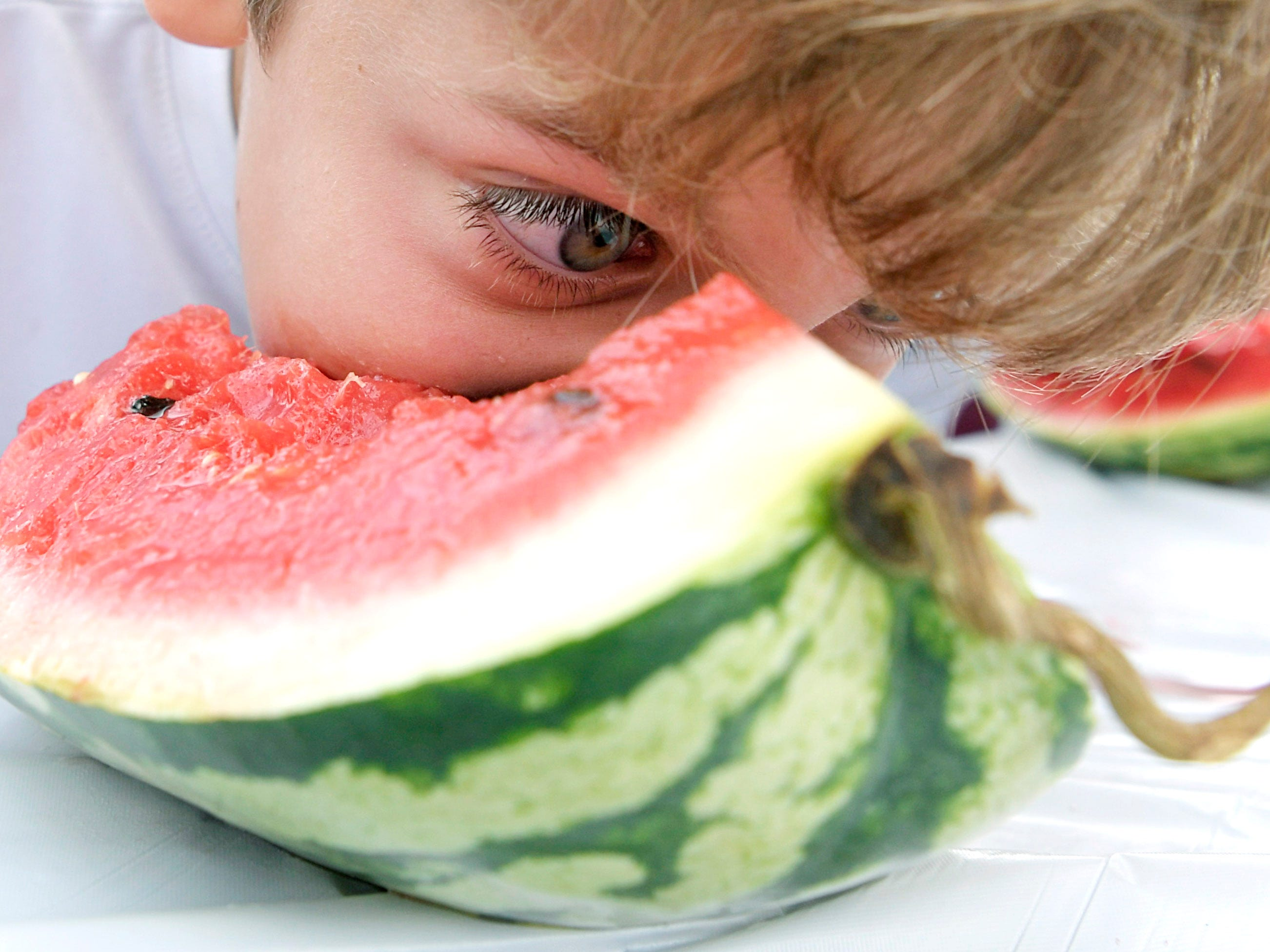 Toby Sarnacke of Franjklin competes in teh Franklin Watermelon Festival's watermelon eating contest at the Franklin Farmers Market on Saturday,  August 18, 2018.