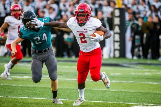 Immokalee sophomore Raheem Toombs runs the ball during the preseason game at Gulf Coast High School on Friday, Aug. 17, 2018.