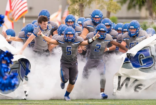 Barron Collier takes the field for the preseason game against Lely at Barron Collier High Friday night, Aug. 17, 2018.