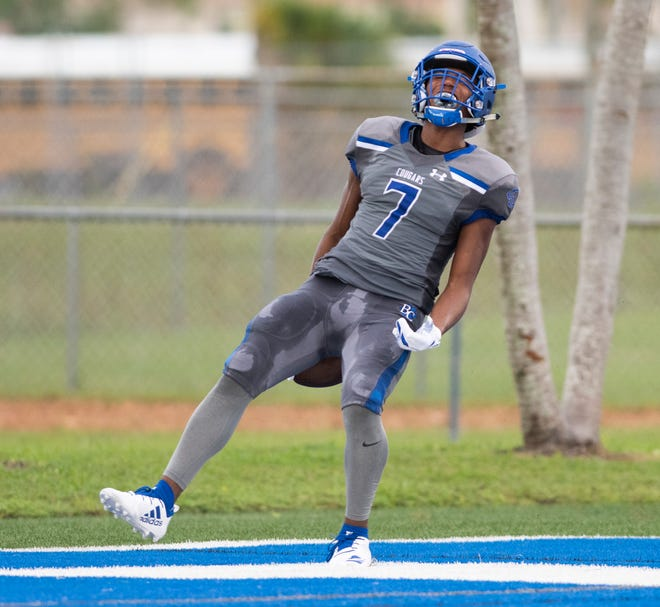 Jayden Rolle of Barron Collier celebrates running for a touchdown during the preseason game against Lely at Barron Collier High Friday night, Aug. 17, 2018.