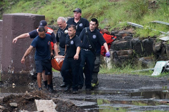 Paterson first responders rescue a man from the water at Paterson Great Falls National Historical Park on Saturday, August 18, 2018.