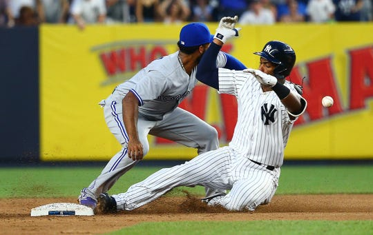 New York Yankees third baseman Miguel Andujar (41) slides into second base after hitting an RBI double against the Toronto Blue Jays during the first inning at Yankee Stadium.