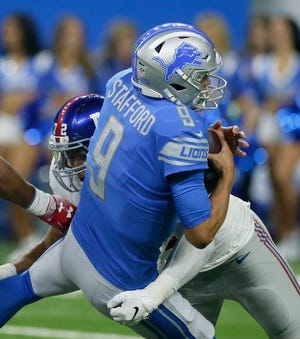 Detroit Lions quarterback Matthew Stafford (9) is sacked by New York Giants defensive end Kerry Wynn (72) during the first half of an NFL football game, Friday, Aug. 17, 2018, in Detroit.