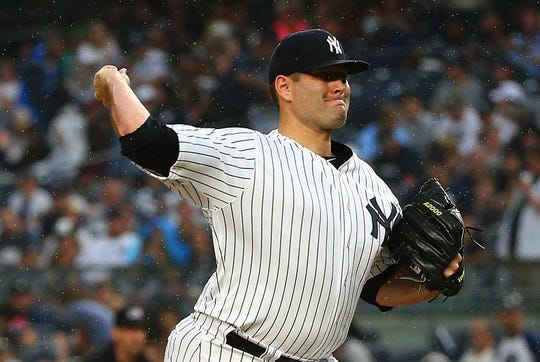 New York Yankees starting pitcher Lance Lynn (36) pitches against the Toronto Blue Jays during the first inning at Yankee Stadium.