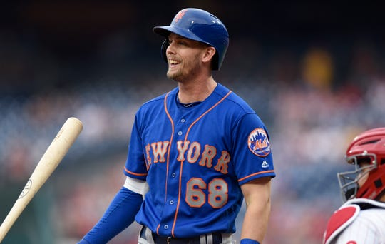 New York Mets' Jeff McNeil (68) reacts after he strikes out during the first inning of a baseball game against the Philadelphia Phillies, Friday, Aug. 17, 2018, in Philadelphia.