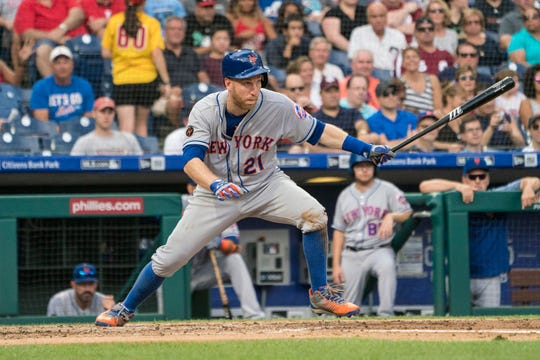 Aug 18, 2018; Philadelphia, PA, USA; New York Mets thrid baseman Todd Frazier (21) hits a single during the fourth inning of the game against the Philadelphia Phillies at Citizens Bank Park.