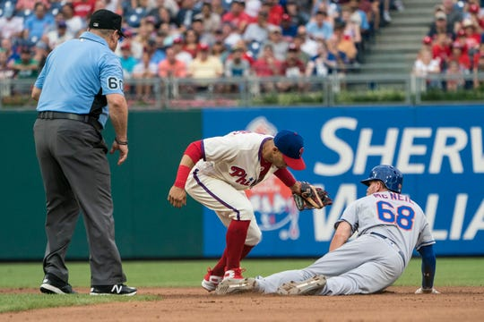 Aug 18, 2018; Philadelphia, PA, USA; New York Mets second baseman Jeff McNeil (68) steals second base ahead of the tag by Philadelphia Phillies second baseman Scott Kingery (4) during the sixth inning of the game at Citizens Bank Park.
