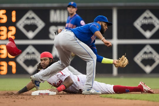 Philadelphia Phillies third baseman Maikel Franco (7) steals second base against New York Mets shortstop Amed Rosario (1) during the first inning at Citizens Bank Park.
