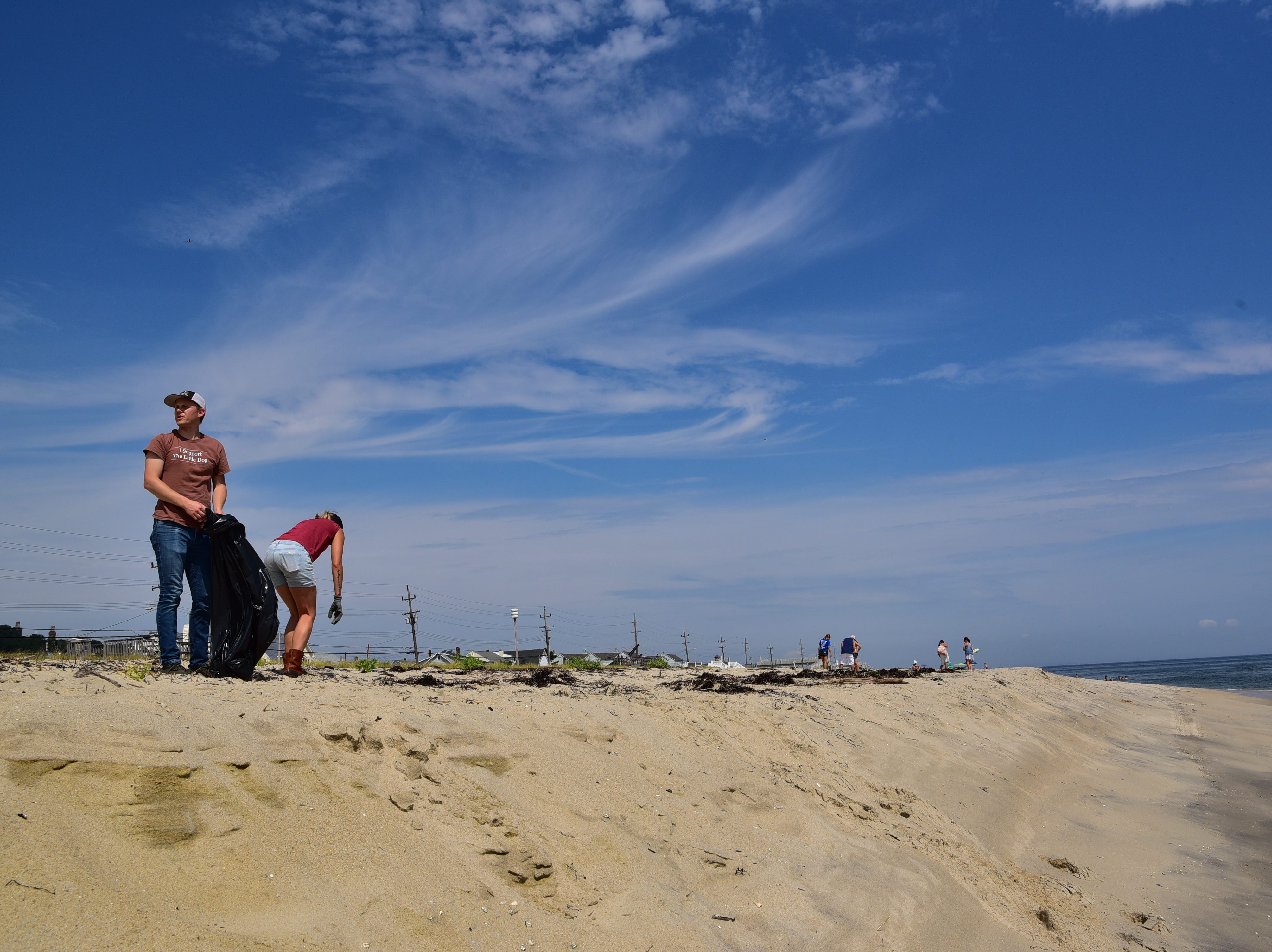 Volunteers pick up trash and plastic from the beach in Sea Bright on Saturday.