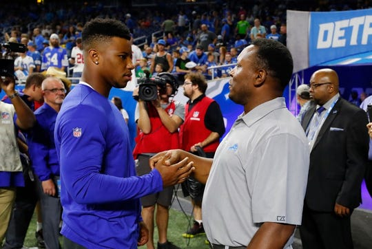New York Giants running back Saquon Barkley, left, meets with former Detroit Lions running back Barry Sanders before a preseason football game, Friday, Aug. 17, 2018, in Detroit.