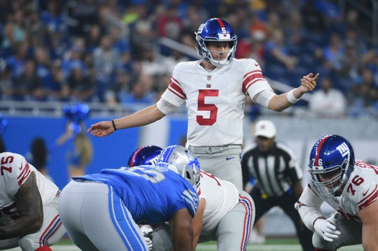 New York Giants quarterback Davis Webb (5) during the first quarter against the Detroit Lions at Ford Field.