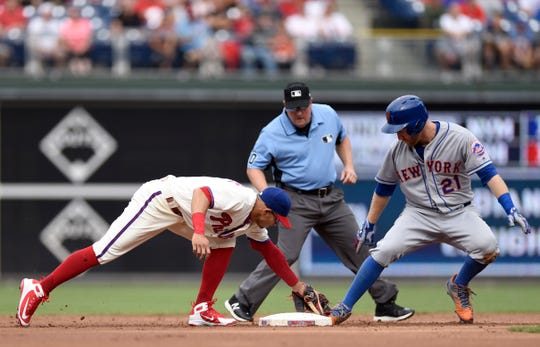 New York Mets' Todd Frazier (21) slides into second base ahead of a tag from Philadelphia Phillies' Cesar Hernandez (16) in the second inning of a baseball game, Saturday, Aug. 18, 2018, in Philadelphia.